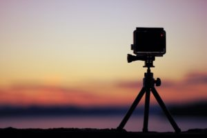 image of GoPro Hero 6 on small tripod filming time lapse video