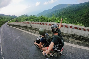 two guys filming motorcycle ride with GoPro